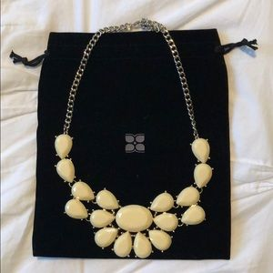 Cream stone statement necklace on a gold chain